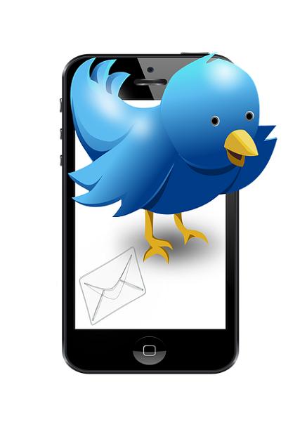 Pájaro de Twitter saliendo de un móvil